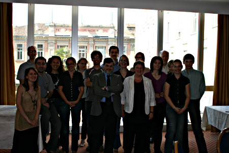 All young scholars and a few professors and collaborators pose together for a picture.